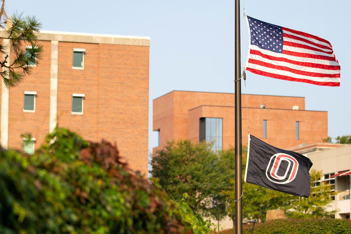 The UNO flag lowered next to the Pep Bowl