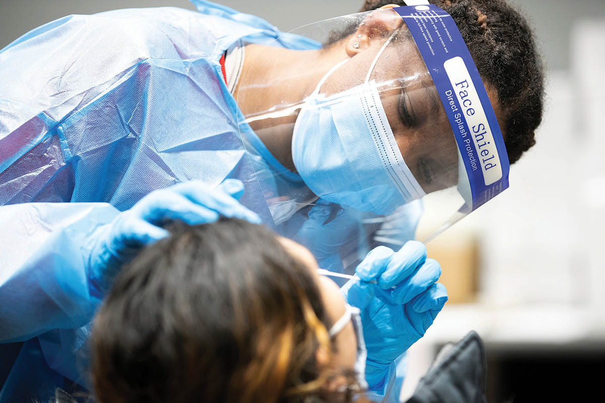 UNO Public Health student Rhea Flowers administers a COVID-19 test to a fellow studen