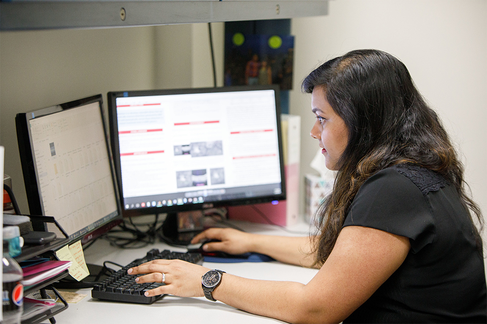 student sitting at a computer.