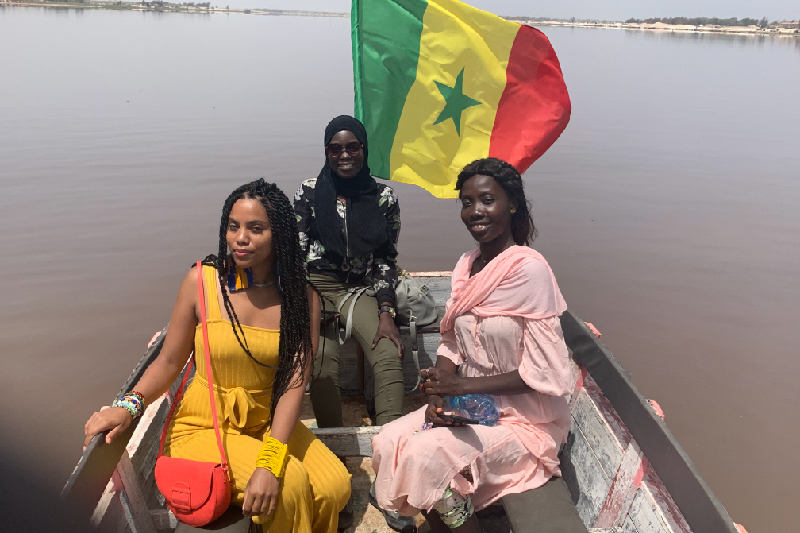 Dombeck and friends with a Senegal flag on water