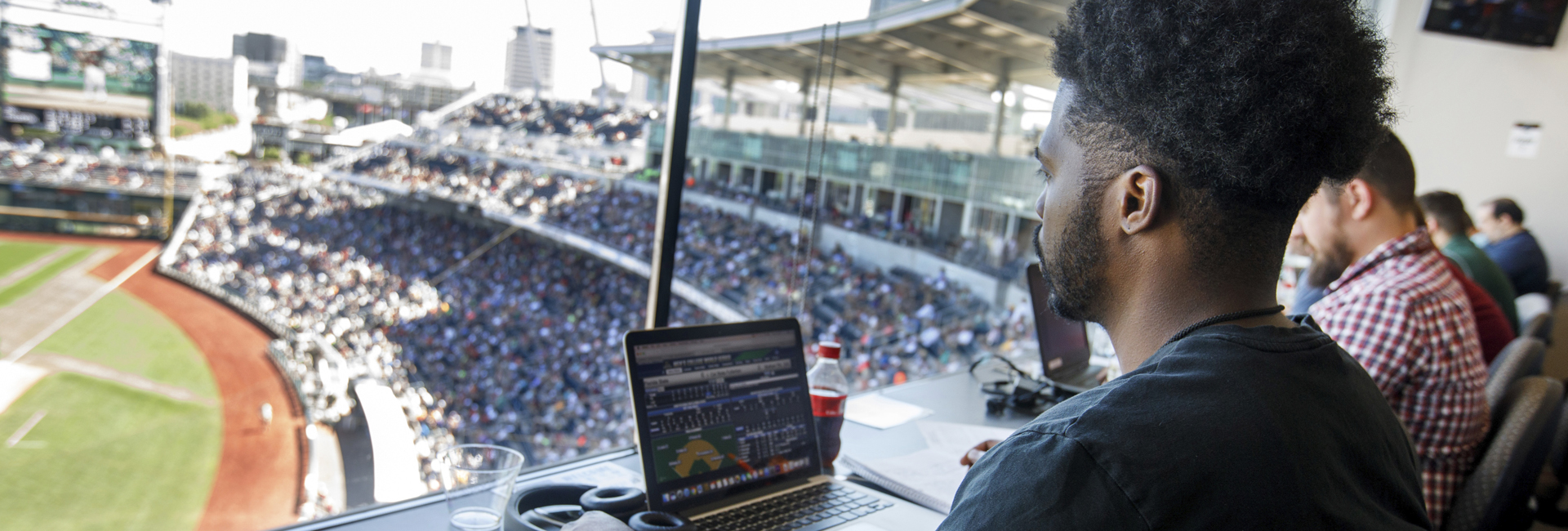 Student Covers CWS from the Press Box