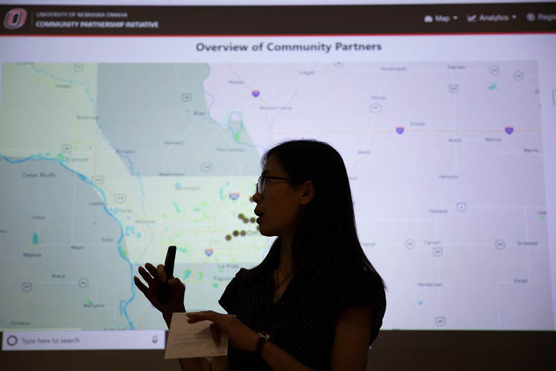 MIS student Lingli Gan presents a progress report on a Community Engagement tool being developed as part of an IS&T capstone course