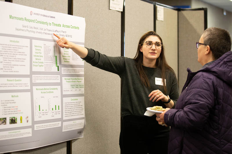 A student presents her research poster at the 2019 Student Research and Creative Activity Fair