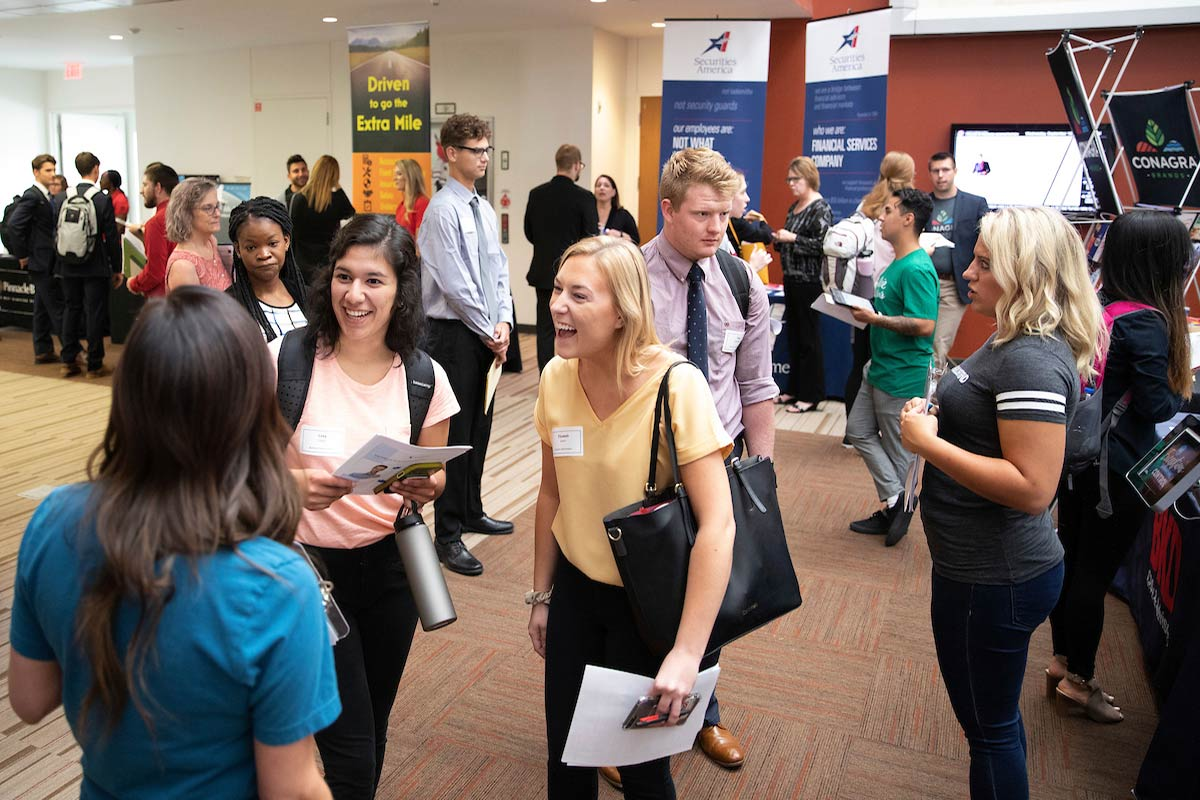 Student interacts with professionals at the career fair